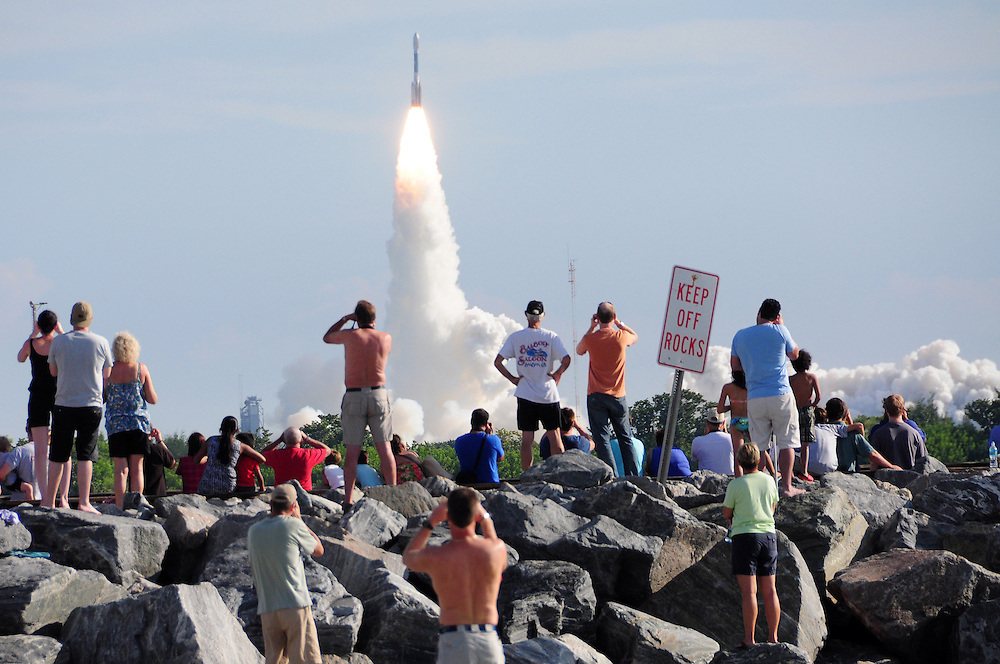 Andrew Knapp, FLORIDA TODAY -- Sept. 10, 2011 -- Spectators at Jetty Park in Port Canaveral watch the launch of a Delta II Heavy rocket carrying NASA's GRAIL spacecraft toward the moon Saturday morning.