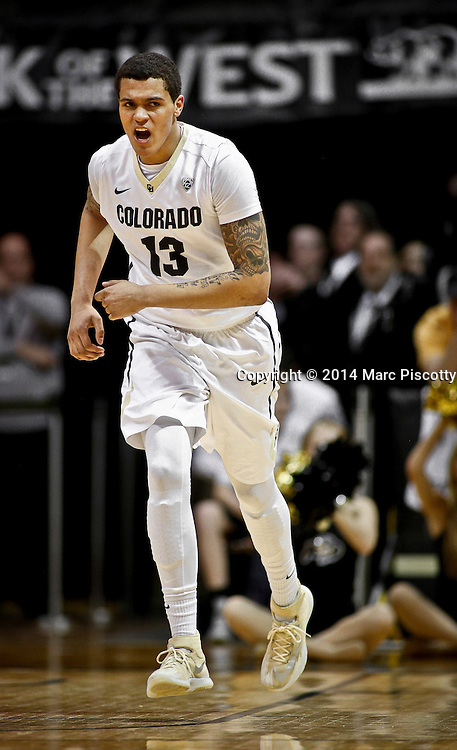 SHOT 2/19/14 11:50:11 PM - Colorado's Dustin Thomas #13 reacts after scoring a basket against Arizona State during their regular season Pac-12 basketball game at the Coors Events Center in Boulder, Co. Colorado won the game 61-52.<br /> (Photo by Marc Piscotty / &copy; 2014)
