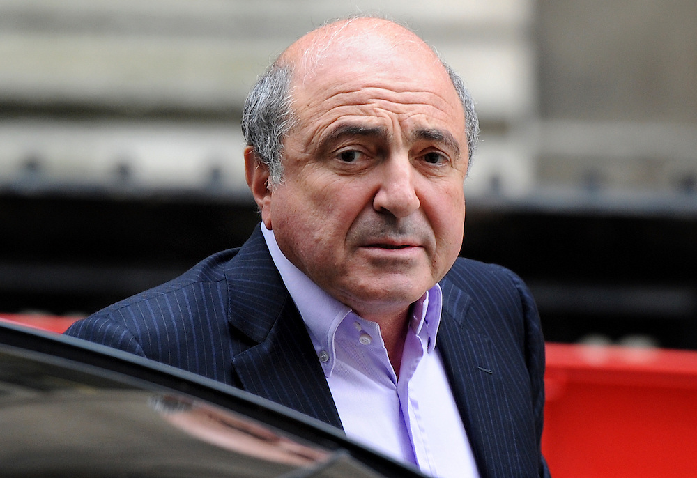 Russian businessman Boris Berezovsky (R) arrives at The High Court on October 4, 2011 in London, England. Mr Berezovsky is alleging a breach of contract over business deals with fellow Russian and Chelsea Football Club owner Roman Abramovich and is claiming more than £3.2bn in damages.....