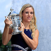 2016 U.S. Open - Day 14  US Open women's singles champion Angelique Kerber with the US Open championship trophy outside Arthur Ashe Stadium on day fourteen of the 2016 US Open Tennis Tournament at the USTA Billie Jean King National Tennis Center on September 11, 2016 in Flushing, Queens, New York City.  (Photo by Tim Clayton/Corbis via Getty Images)
