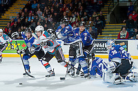 KELOWNA, CANADA -FEBRUARY 8: Kris Schmidli #16 of the Kelowna Rockets is checked between Taylor Crunk #22 and  Jake Kohlhauser #7 of the Victoria Royals on February 8, 2014 at Prospera Place in Kelowna, British Columbia, Canada.   (Photo by Marissa Baecker/Getty Images)  *** Local Caption *** Kris Schmidli; Taylor Crunk; Jake Kohlhauser;