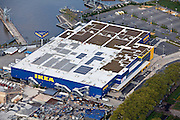 On the rooftop of IKEA there are solar panels/collectors as well as small urban garden plots in New York City.