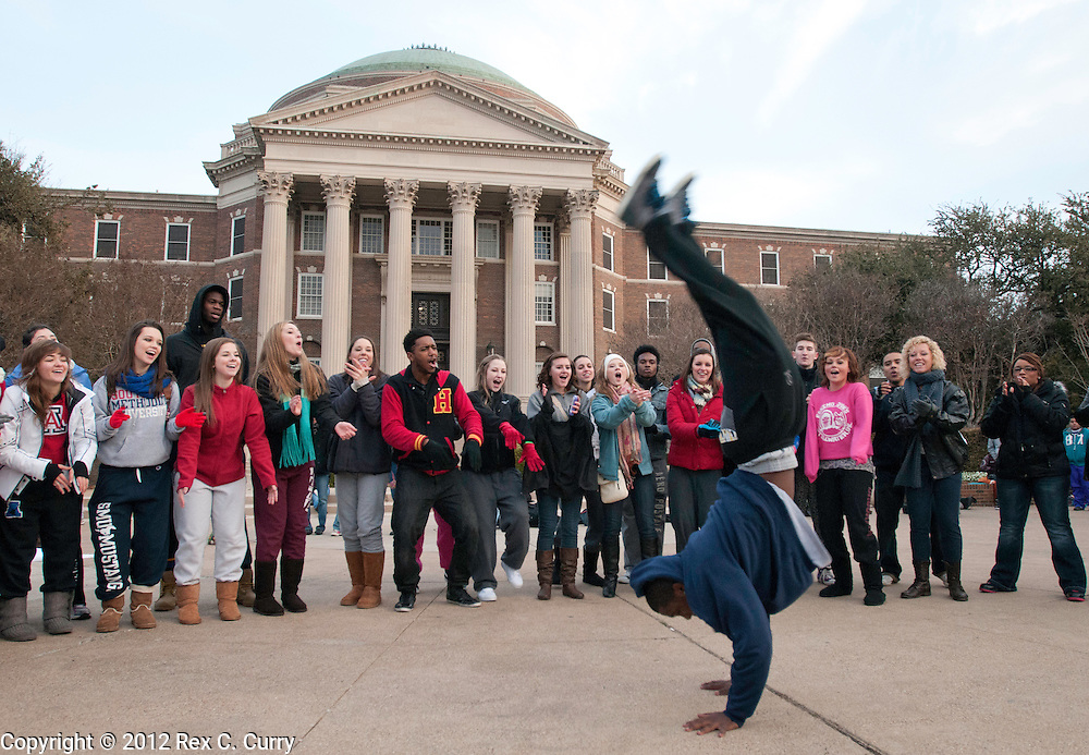 "Jonas Suber, from Prairie View, Tx.  dances for a production crew while waiting in the early morning cold to audition for ""So You Think You Can Dance"" at SMU on Friday, Jan. 13, 2012."