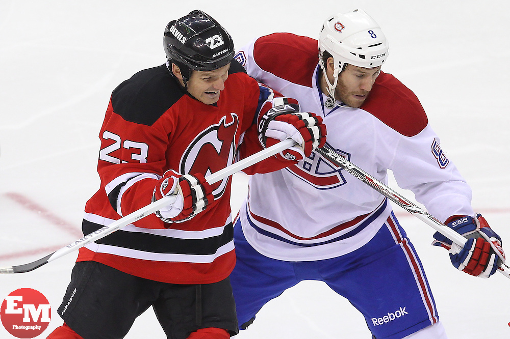 Apr 23, 2013; Newark, NJ, USA; New Jersey Devils center David Clarkson (23) and Montreal Canadiens right wing Brandon Prust (8) battle for position during the third period at the Prudential Center. The Devils defeated the Canadiens 3-2.