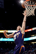 Oct 16, 2014; Phoenix, AZ, USA; Phoenix Suns guard Goran Dragic (1) lays up the basketball against the San Antonio Spurs in the first half at US Airways Center. Mandatory Credit: Jennifer Stewart-USA TODAY Sports
