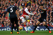 Sead Kolasinac of Arsenal's &copy; sees his  shot  deflected off Federico Fernandez of Swansea City (R). Premier league match, Arsenal v Swansea city at the Emirates Stadium in London on Saturday 28th October 2017.<br /> pic by Steffan Bowen, Andrew Orchard sports photography.
