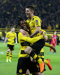 DORTMUND, March 12, 2018  Michy Batshuayi (L) of Dortmund celebrates with his teammates during the German Bundesliga soccer match between Borussia Dortmund and Eintracht Frankfurt in Dortmund, Germany, on March 11, 2018. Dortmund won 3-2. (Credit Image: © Joachim Bywaletz/Xinhua via ZUMA Wire)