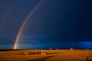 bales and raibow with storm clouds<br />