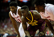 Center Bakary Konaté prepares to rebound during the first half of the University of Minnesota Men's Basketball game versus University of Wisconsin on March 5, 2017.