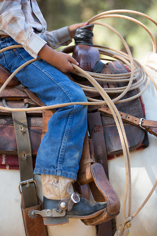 One young cowboy wears fancy boots with spurs and other embellishments at the 62nd Annual Woodside Junior Rodeo.