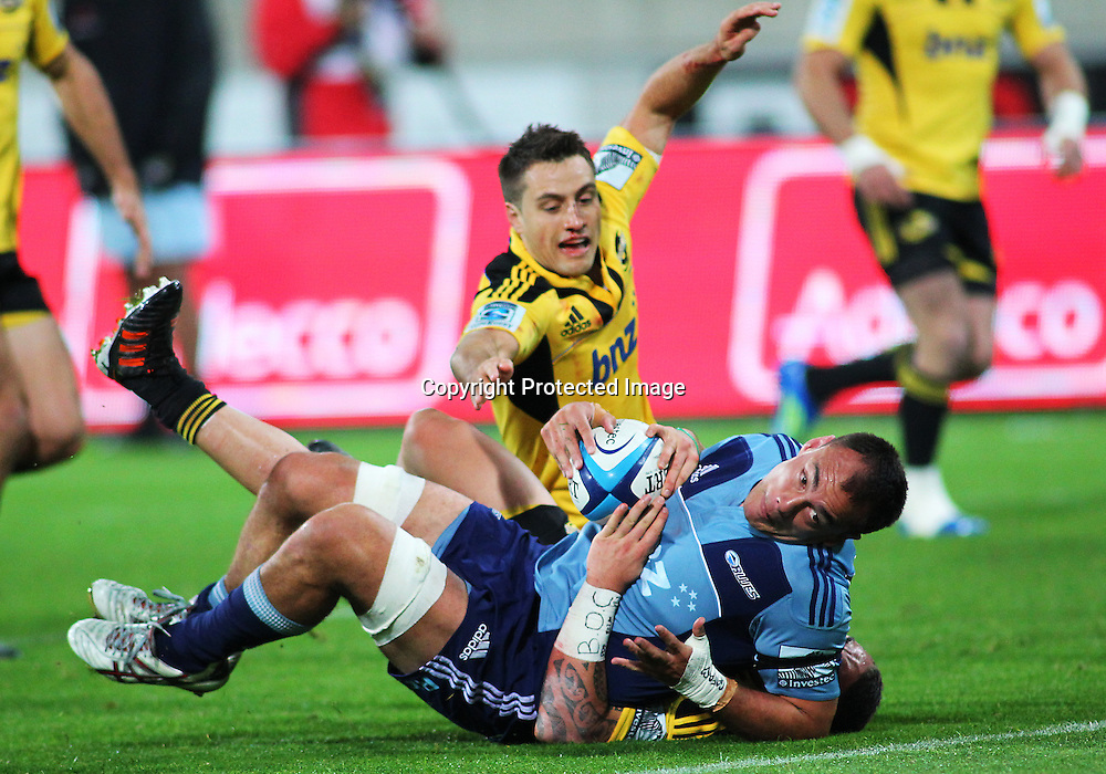 Blues' loose forward Chris Lowrey looks to reach for the try line during their Super Rugby match, Hurricanes v Blues, Westpac stadium, Wellington, New Zealand. Friday 4 May 2012.  PHOTO: Grant Down / photosport.co.nz