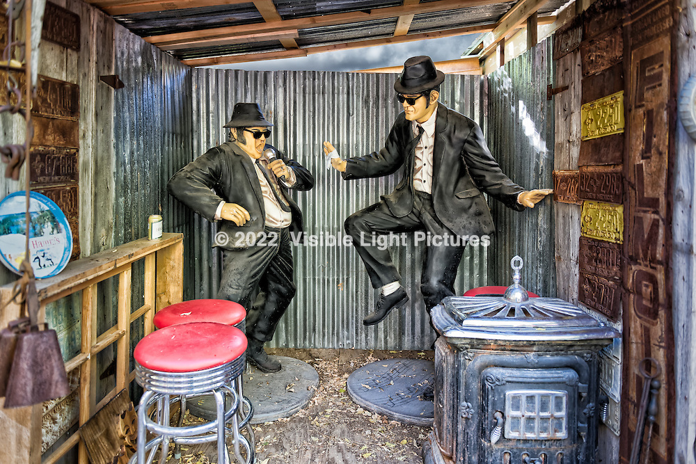 """Jake and Elwood at the Classical Gas Museum in Embudo, New Mexico.  The proprietor of this off-beat museum has what is believed to be one of the largest collections of antique gas pumps to be found just about anywhere.  There are several vehicles on the property in various states of decomposition, along with an entire diner that had been relocated to the site in its entirety.  This full-sized """"Blues Brothers"""" diorama, featuring Jake and Elwood, also resides there."""