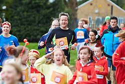 © Licensed to London News Pictures.  23/03/2014. OXFORD, UK. Prime minister DAVID CAMERON (centre) at the start of the Oxford Sport Relief Mile. Photo credit: Cliff Hide/LNP