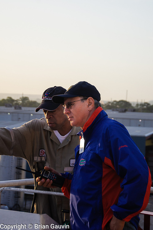 Florida Harbor Pilot, Capt. Richard Heston (blue) and Capt. Calvin Patterson on Legacy bridge wing leaving Marathon Oil dock in Tampa, Fl.