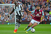 Newcastle United midfielder Mohamed Diame (15) plays a pass watched by Aston Villa midfielder Mile Jedinak (25) during the EFL Sky Bet Championship match between Aston Villa and Newcastle United at Villa Park, Birmingham, England on 24 September 2016. Photo by Alan Franklin.