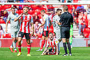 Chris Maguire (#7) of Sunderland AFC shouts at referee Michael Salisbury after he is fouled during the EFL Sky Bet League 1 match between Sunderland and Portsmouth at the Stadium Of Light, Sunderland, England on 17 August 2019.
