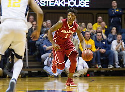 Jan 18, 2017; Morgantown, WV, USA; Oklahoma Sooners guard Rashard Odomes (1) dribbles the ball up the floor late in the second half against the West Virginia Mountaineers at WVU Coliseum. Mandatory Credit: Ben Queen-USA TODAY Sports
