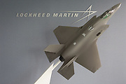 The Lockheed Martin logo and a model of their F-35 Lightening fighter in the company's hospitality chalet at the Farnborough Airshow, on 18th July 2018, in Farnborough, England.