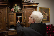 New York, NY, April 2, 2016. Franciscan Brother Paschal DeMattea, O.F.M. holds chalice in the sacristy of St. Anthony of Padua in New York City. 04/02/2016. Photo by George Goss/NYCity News Service.