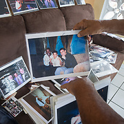 SEPTEMBER 25 - CANOVANAS, PUERTO RICO - <br /> Jose Torres's re arranges some of the photos he was able to save in  his San Isidro neighborhood home. During the path of Hurricane Maria, Torres, a boxing instructor, decided to arrange his photos in his living room assuming he and his wife wouldn't  survive the floods. He is a diabetic and lost all his medications.<br /> (Photo by Angel Valentin for NPR)