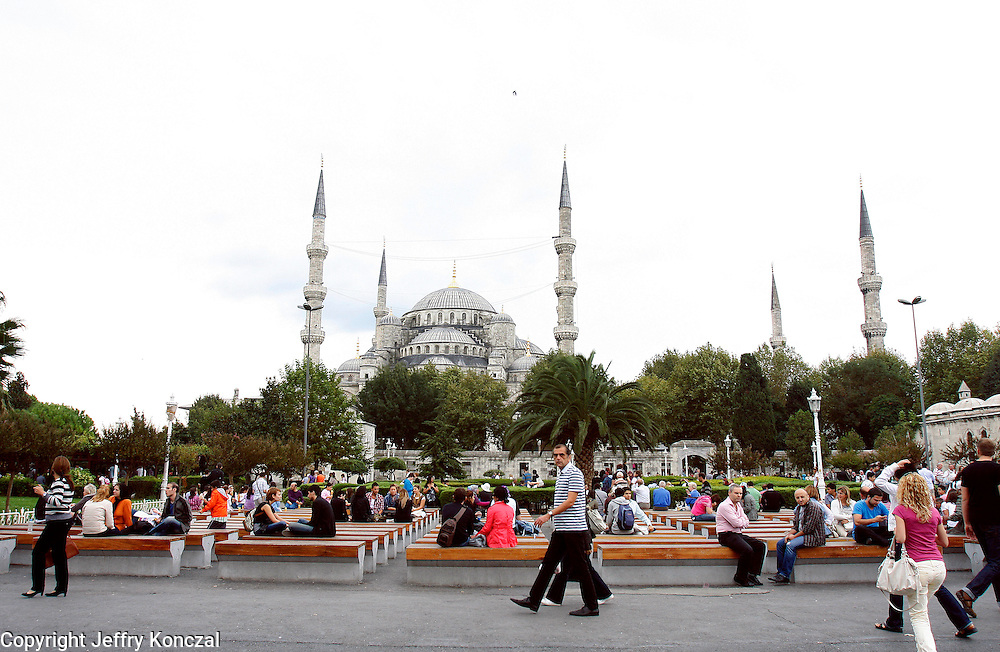 People relaxing outside of Blue Mosque in Istanbul, Turkey