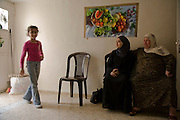 Palestinian guide and driver Abdul-Baset Razem's daughter with her aunt and grandmother at their home in a Palestinean village in East Jerusalem. (Abdul-Baset Razem is featured in the book What I Eat: Around the World in 80 Diets.)