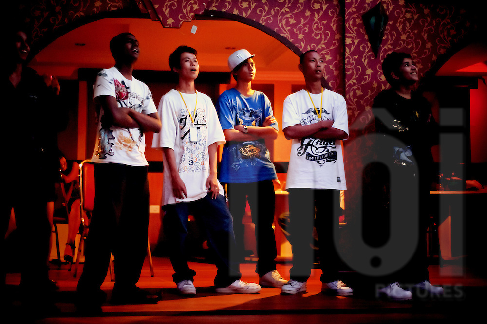 Rappers waiting to go on stage at a hip-hop concert in Yangon.