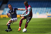 Millwall midfielder Jed Wallace (14) and Aston Villa forward Jonathan Kodjia (22) during the EFL Sky Bet Championship match between Millwall and Aston Villa at The Den, London, England on 6 May 2018. Picture by Toyin Oshodi.