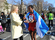 Kate Perkins, Second Secretary for Scottish Affairs, presents Werkuneh Seyoum Aboye, of Ethiopia, with a traditional Scottish friendship cup after he won the 12th annual Scotland Run in New York's Central Park, Saturday, April 4, 2015, as part of Scotland Week.  (Photo by Diane Bondareff/Invision for Scottish Government/AP Images)