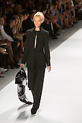 Black chalkstripe pants suit. By Zang Toi, shown at his Spring 20132 Fashion Week show in New York.