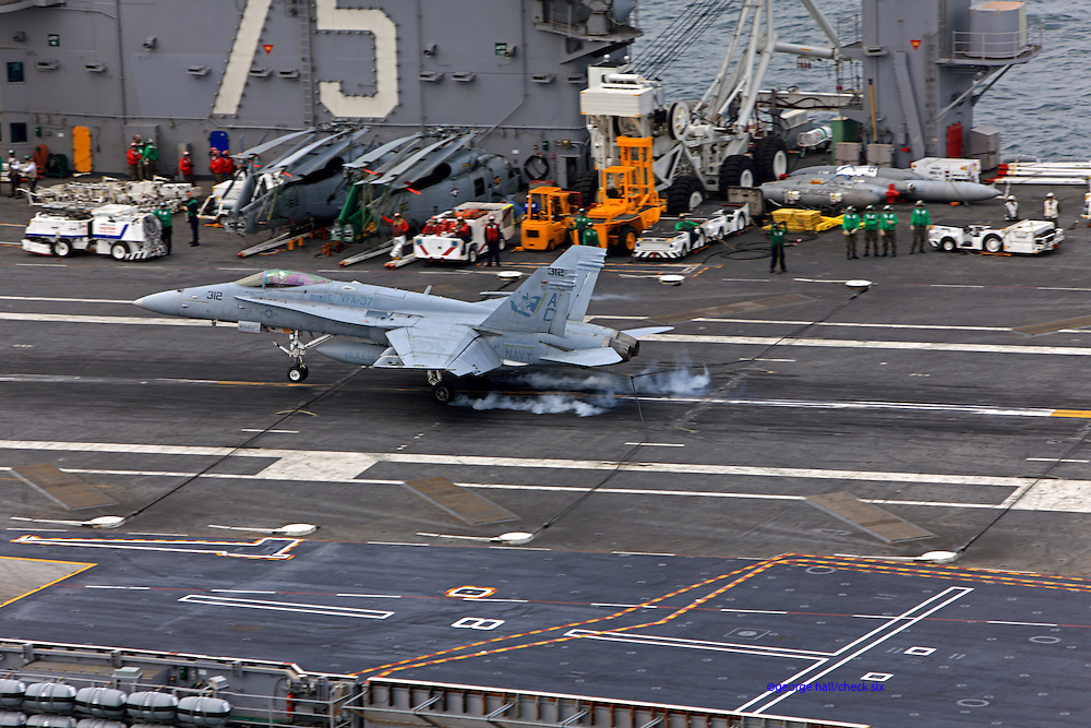 A Boeing F/A-18C Hornet, AC 312 165174 from VFA-37 'Bulls' catches the two-wire on the deck of CVN-75 USS Harry S. Truman.