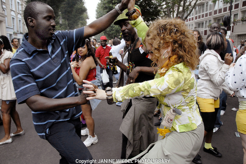Dancing in side street Notting Hill Carnival
