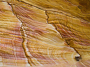 "Red, orange, yellow, brown, and white sandstone rock patterns are exposed in the Painted Cliffs of Maria Island National Park, Darlington, Tasmania, Australia. Undercut by the Tasman Sea (South Pacific Ocean), the Painted Cliffs date from the Permian and Triassic, 300-200 million years ago. Published in ""Light Travel: Photography on the Go"" book by Tom Dempsey 2009, 2010."