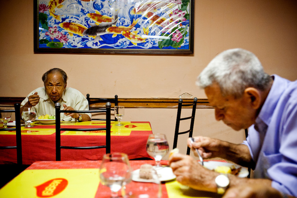 Elder Chinese-Cubans eat lunch at a Chinese restaurant in Barrio Chino, Havana, Cuba, on Friday, April 18, 2008..