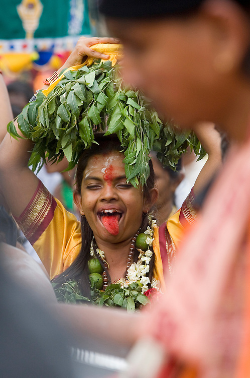 "A hindu devotee in the state of trance makes his way to the sacred Batu Caves temple during the Thaipusam festival in Kuala Lumpur, Malaysia. Hindu devotees celebrate Thaipusam festival in honour of the Lord Murugan (also known as Lord Subramaniam). Thousands of Hindu devotees carried the milk pots and ""kavadi"" (a gaily decorated wooden or metal frame) walk barefoot up the temple's 272 steps to undergo penance in fulfilling vows made to Lord Murugan for answering their prayers."