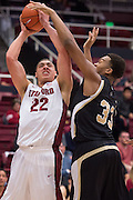 November 14, 2014; Stanford, CA, USA; Stanford Cardinal forward Reid Travis (22) shoots the basketball against Wofford Terriers forward Cameron Jackson (33) during the first half at Maples Pavilion.