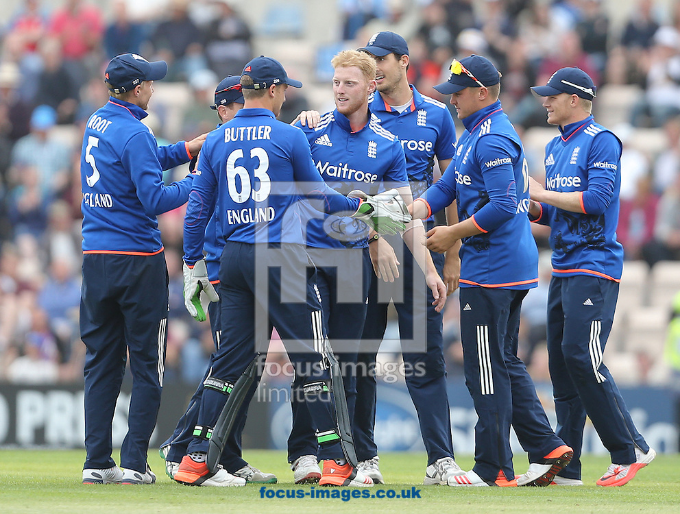 Ben Stokes ( 4th R ) of England celebrates taking the wicket of Luke Ronchi ( not pictured ) of New Zealand during the Royal London One Day Series match at the Ageas Bowl, West End<br /> Picture by Paul Terry/Focus Images Ltd +44 7545 642257<br /> 14/06/2015