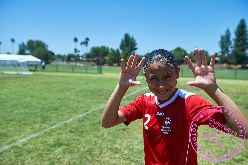 SO Poland athlete smiles while football women match 7-a-side during fourth day of the Special Olympics World Games Los Angeles 2015 on July 28, 2015 at Balboa Sports Centre in Los Angeles, USA.<br /> USA, Los Angeles, July 28, 2015<br /> <br /> Picture also available in RAW (NEF) or TIFF format on special request.<br /> <br /> For editorial use only. Any commercial or promotional use requires permission.<br /> <br /> Adam Nurkiewicz declares that he has no rights to the image of people at the photographs of his authorship.<br /> <br /> Mandatory credit:<br /> Photo by &copy; Adam Nurkiewicz / Mediasport