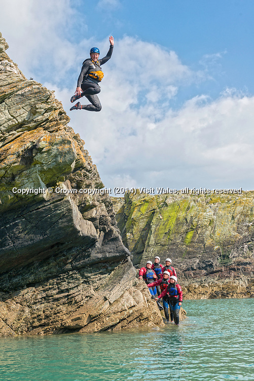 Group coasteering<br /> Near Rhoscolyn<br /> Holy Island<br /> Anglesey<br /> North <br /> Coasteering<br /> Activities and Sports