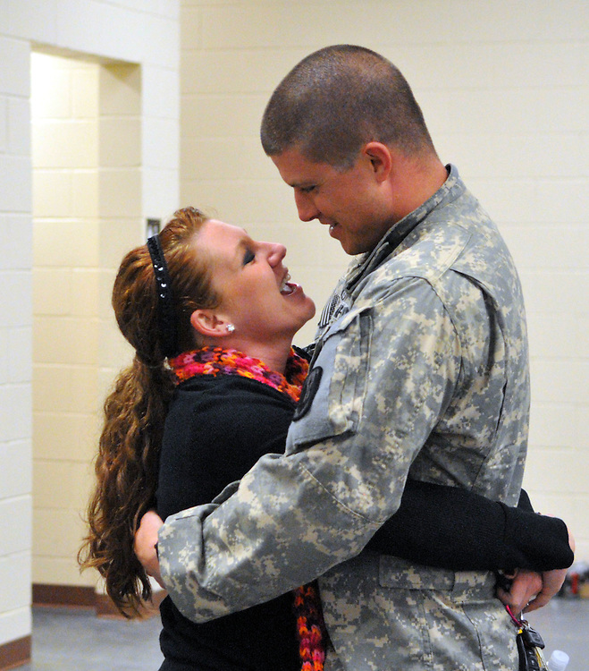 Daniel Moore and his wife K.T. Meckes Moore embrace Tuesday night at Camp Shelby. The couple were married during Daniel's two-week leave three months ago. Moore was one of two bus loads of the 185th Aviation division of the Mississippi National Guard who returned home from Iraq to Camp Shelby. Bryant Hawkins/ Hattiesburg American