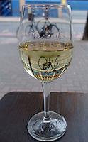 White vine glass and a bike