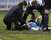 Ross County keeper Antonio Reguero is treated by Dundee FC doctor Angela Duncan - Dundee v Ross County, SPFL Premiership at Dens Park<br /> <br />  - &copy; David Young - www.davidyoungphoto.co.uk - email: davidyoungphoto@gmail.com