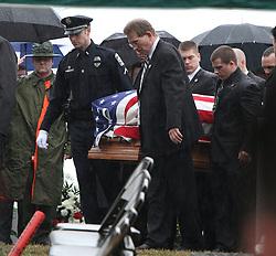February 21, 2011: Bridgeport City Police Officer Dustin Hotsinpiller, brother of Derek Hotsinpiller, is seen carrying the casket of his brother into the burial site of deputy U.S. marshal Derek Hotsinpiller.  (Photo by: Ben Queen)