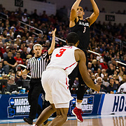 15 March 2018: San Diego State Aztecs guard Trey Kell (3) steps back for three point shot over Houston Cougars guard Armoni Brooks (3) in the first half. The San Diego State Aztecs got knocked out in the first round by Houston on a last second layup to lose 67-65  at Intrust Bank Arena in Wichita, Kansas.