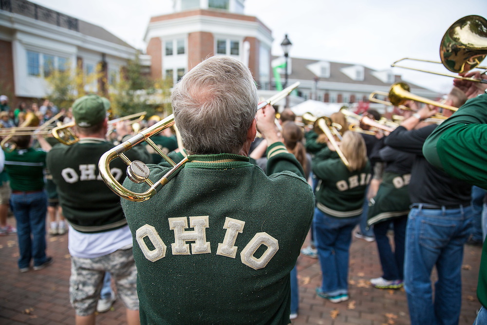 The alumni Marching 110 band plays at the Homecoming Parade on Oct. 11, 2014.