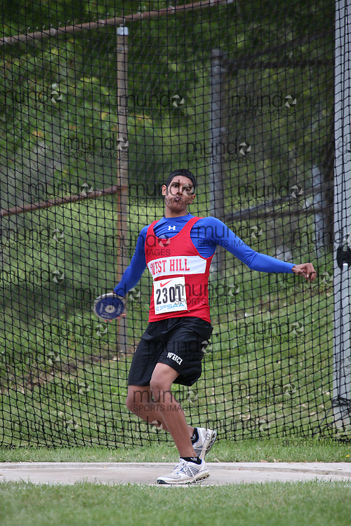Brendan Shivratan of West Hill CI - Scarborough competes in the midget boys discus at the 2013 OFSAA Track and Field Championship in Oshawa Ontario, Thursday,  June 6, 2013.<br /> Mundo Sport Images / Sean Burges