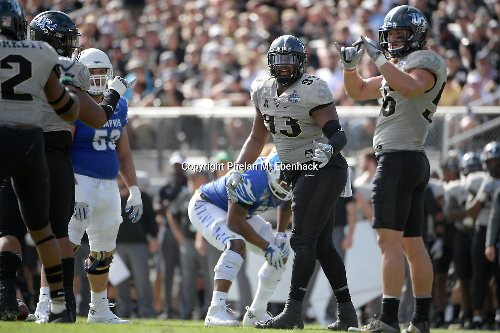 Central Florida defensive lineman Tony Guerad (93) sets up for a play during the first half of the American Athletic Conference championship NCAA college football game against Memphis Saturday, Dec. 2, 2017, in Orlando, Fla. (Photo by Phelan M. Ebenhack)