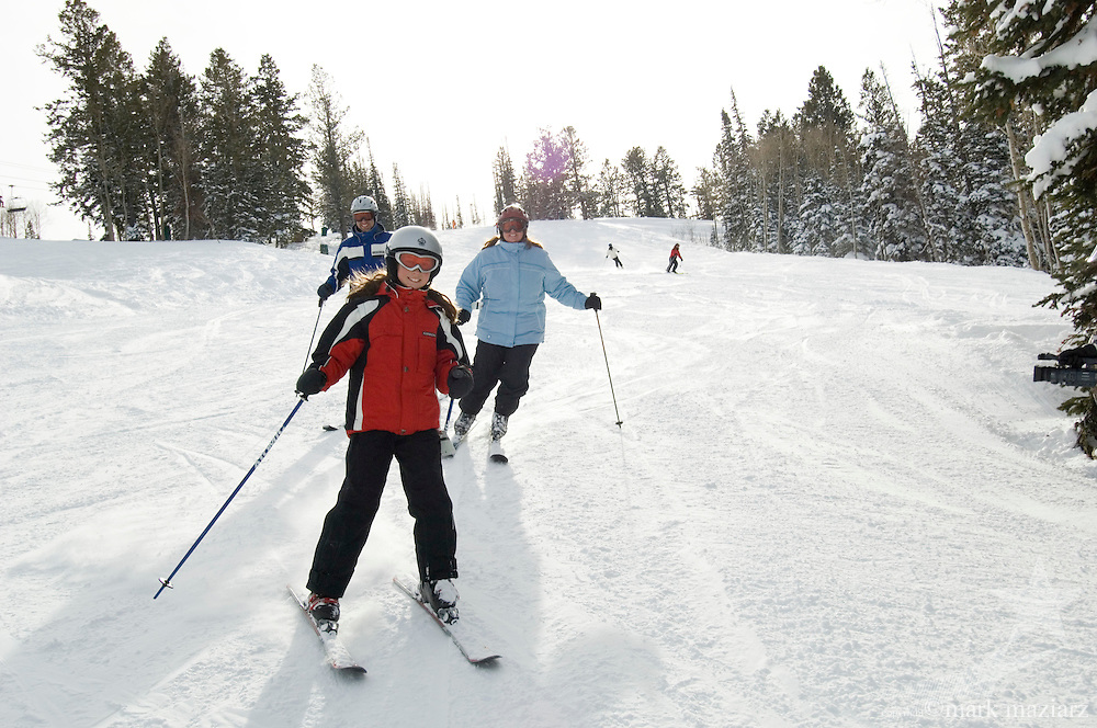 family of father, mother & daughter skiing at Deer Valley Resort