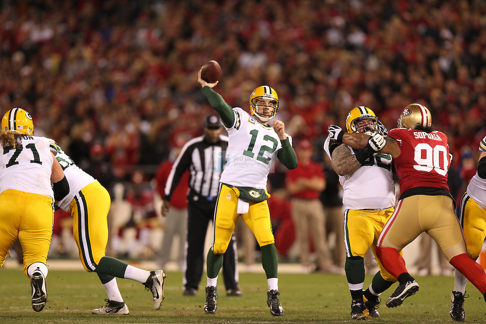 Green Bay Packers quarterback Aaron Rodgers (12) passes during a NFL Divisional playoff game against the San Francisco 49ers at Candlestick Park in San Francisco, Calif., on Jan. 12, 2013. The 49ers defeated the Packers 45-31. (AP Photo/Jed Jacobsohn)