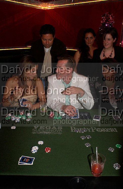 Val Kilmer and Jade Jagger  . PARTYPOKER.COM masterclass hosted by poker author Tony Holden. Ultra Lounge, Selfridges. 11 May 2005. ONE TIME USE ONLY - DO NOT ARCHIVE  © Copyright Photograph by Dafydd Jones 66 Stockwell Park Rd. London SW9 0DA Tel 020 7733 0108 www.dafjones.com